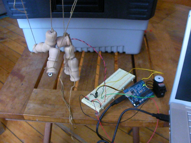 Image of marionette with hands wired for a connection